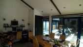 Appartement du propriétaire avec salle à manger donnant sur la cour privée
