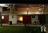 Grange avec 2 stalles à chevaux, sellerie et grande terrasse couverte au premier étage