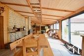 salle à manger dans la véranda chauffée de 77m2