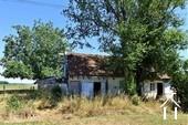 Petite maison avec jardin à rénover