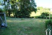 Jardin avec pelouse et potager