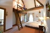 Bedroom on first floor with mezzanine sleeping area in tower