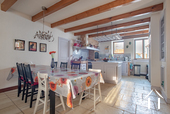 fully equipped kitchen, with dining area